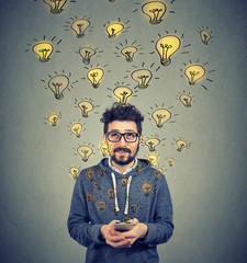 Man with smarpthone developing ideas