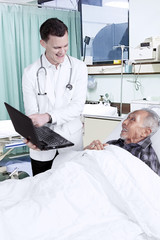 American doctor shows medical report to his patient