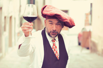 Charismatic wine grower with glass of wine