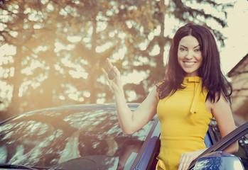 Cheerful woman having new car