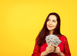 happy successful business woman holding money dollar bills in hand