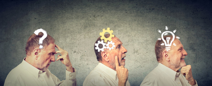 Side view of an elderly man thoughtful, thinking, finding solution with gear mechanism, question, lightbulb