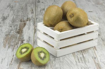 Juicy ripe kiwi fruit in a rustic basket