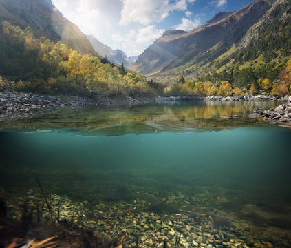 Underwater. Beautiful lake between the green banks and mountains.