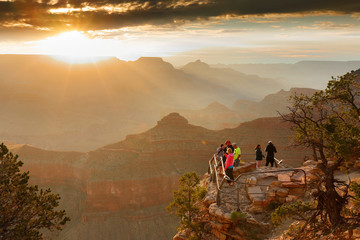 Wall Mural - Sunrise at Grand Canyon. Photo Shows a Group of Tourists Watching Sunrise at Mather Point which is famous for Sunrise.