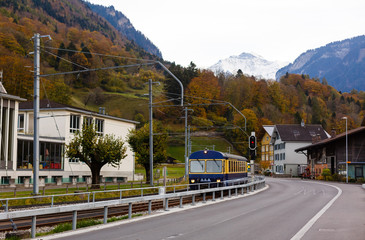 Wall Mural - rural road in switzerland near the mountain jungfrau