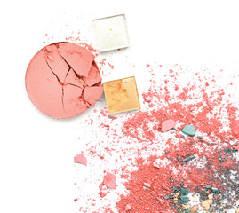 colorful broken make up eyeshadow on white.