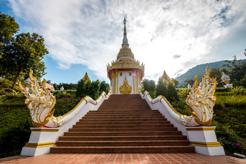 buddhist monastery , naga statue on stair at temple . cloudy and blue sky background . beautiful architecture and ancient landmark of thailand .