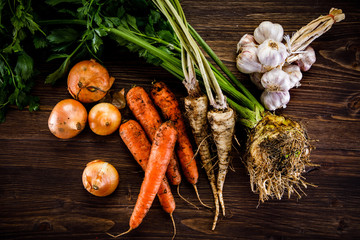 Raw vegetables on wooden background