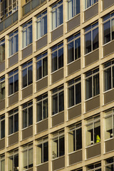 Full frame pattern of windows in a 60's or 70's style office block in London, UK