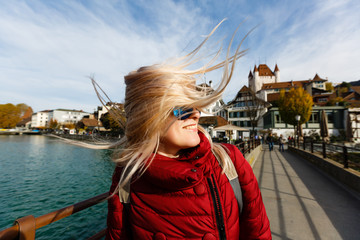 View of a young tourist girl on a bridge in Thun city of switzerland