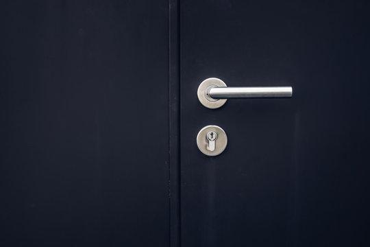Close up keys lock in black door