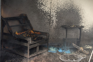 chair and furniture in room after burned in burn scene of arson investigation course