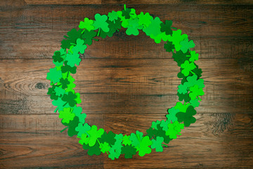 Saint Patrick's Day. circle shape of green three petal clovers on wooden background