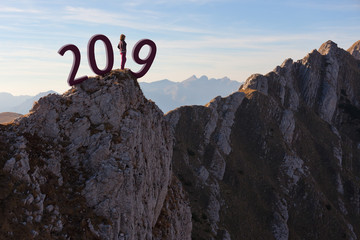 Solitude girl standing on the cliff and worried for 2019