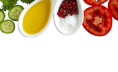 Fresh vegetables, olive oil, herbs and spices isolated on white background