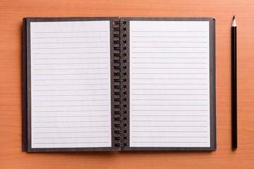Open paper notepad and pencil