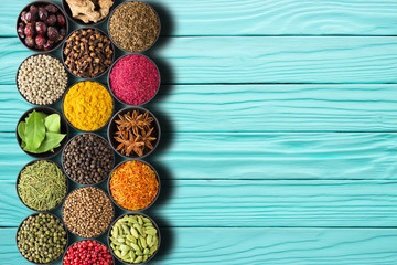 Fototapete - Set of seasonings on a turquoise table with empty space