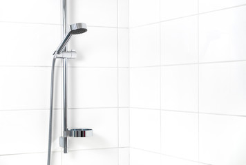 Modern shower with white wall tiles. Simple stylish Scandinavian home interior design. Clean fresh bathroom.