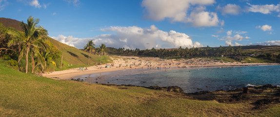 Panoramic of Anakena beach in Easter island in Chile. Blue sea, sand, palms and blue sky in this peacefull place