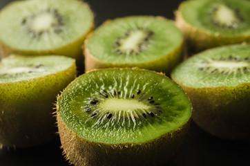 cut fresh  kiwi against black background/cut fresh kiwi against black background. Close up