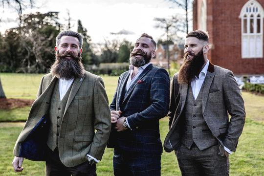 Smart Men with beard and moustache wearing a suit near a castle