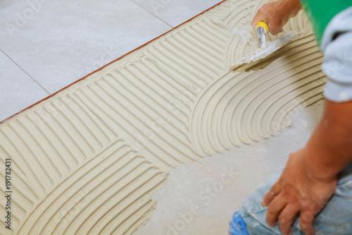 Spreading Wet Mortar Before Applying Tiles On Bathroom Floor Puts