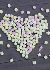 sweet heart shape of marshmallows on wood background, decoration for love and valentine day concept.
