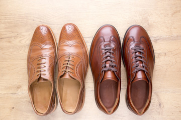 Stylish men leather shoes on wooden background