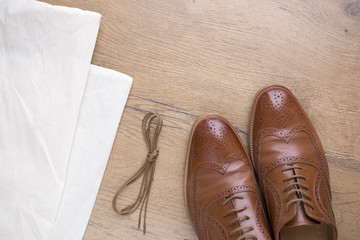 classic brown leather shoes on wooden floor