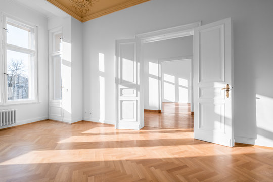 Empty room, flat with stucco ceiling ,  parquet floor and white walls