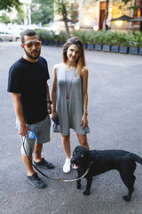 Couple poses with their dog