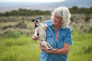 Senior Woman Carrying her Pet Dog
