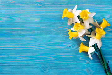 Daffodils bouquet on blue wooden table