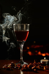 Romantic scene with smoke, wine Glass and Fireplace