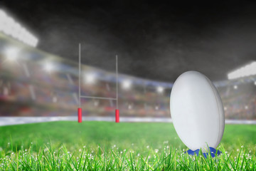 Outdoor Rugby Stadium With Ball on Tee and Copy Space
