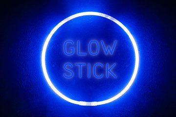 luminous wand/ A round luminous wand on a black board, and an inscription in the middle of luminous letters like neon Glow stick