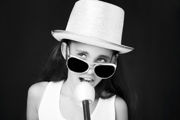 Little girl rocker with sunglasses microphone and hat
