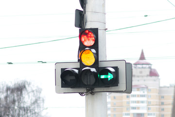 Traffic light with red and yellow burning signals