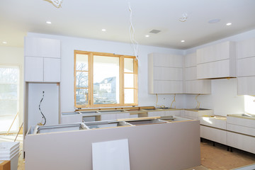 kitchen Cabinet with chipboard shelves with the door open on the hinge. Production of furniture production.