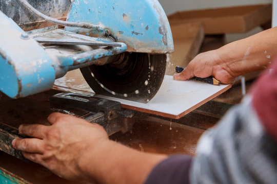Tile being cut on a wet saw for that perfect fit.