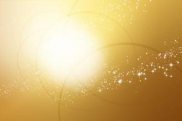 リングと星の金色の抽象的な背景