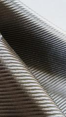 Black carbon fiber composite material background