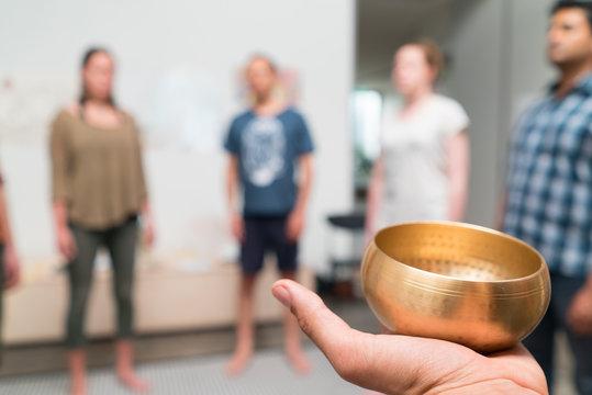 Corporate wellness workshop metitation singing bell