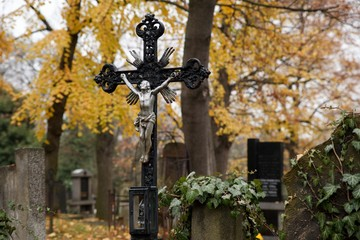 A cross with Jesus Christ in an old cemetery in Prague
