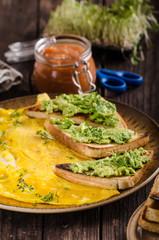 Egg omelette with garlic avocado toast