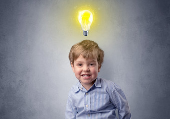Little boy mull over with bulb above his head