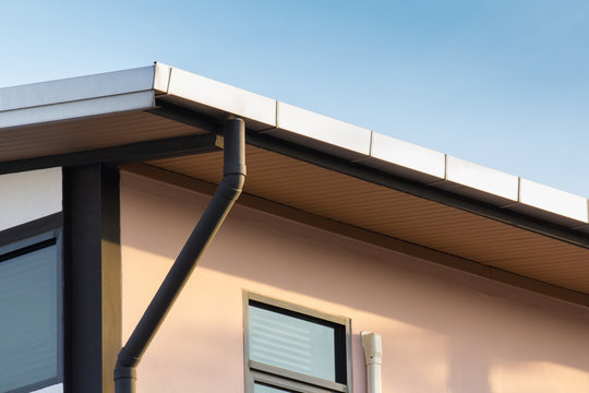 rain gutter of roof with downpipe