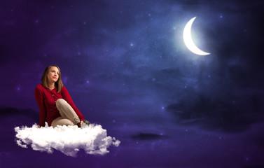 Woman sitting on cloud