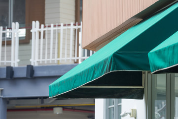 green awning over the shop entrance door